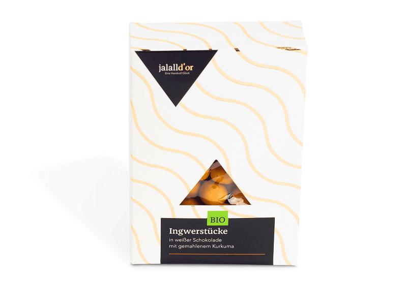 Ingwerstücke in weißer Kurkuma-Schokolade Bio