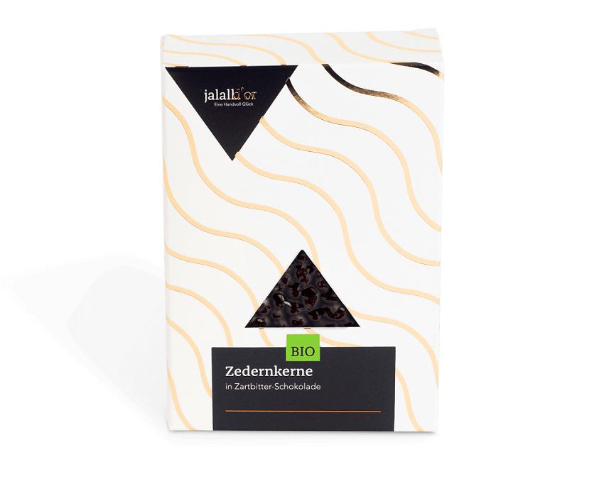 Zedernkerne in Zartbitter-Schokolade bio